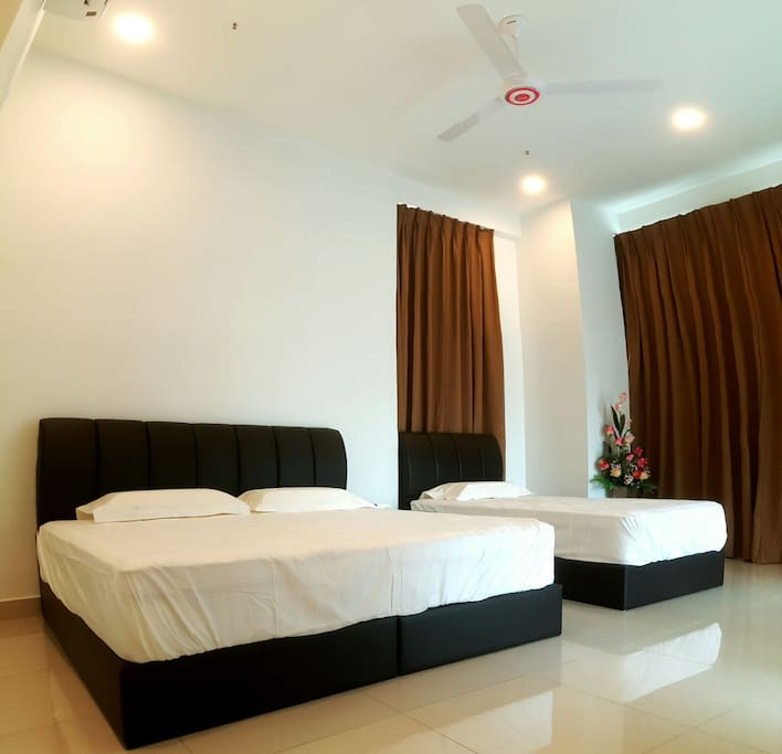 Our Master Living Room are 1 King Bed and 1 Single Bed with Air-conditioning, Fan, WiFi and TV.