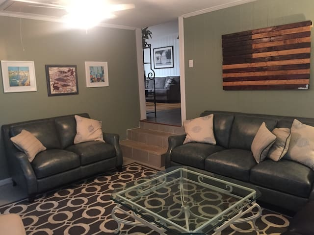 Large TV Room that comfortably sits 8 but can sit 10+