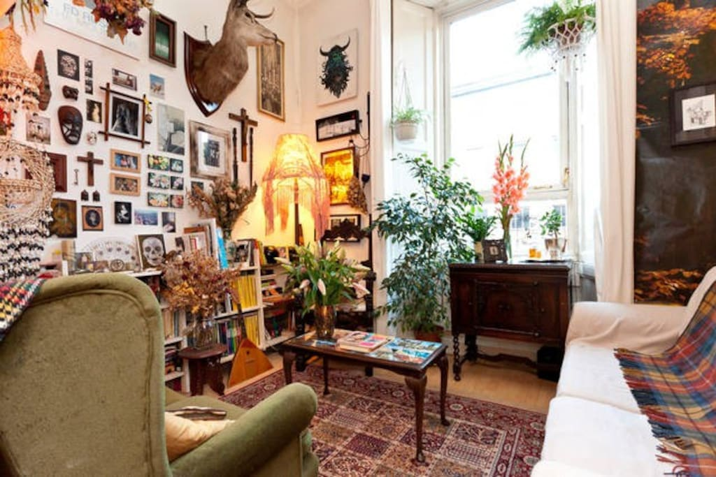 The living room is full of artwork and books to relax with.