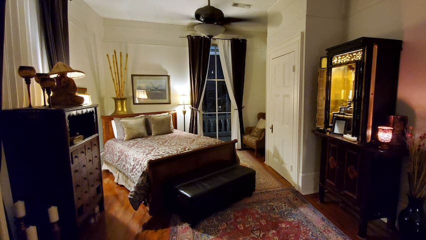 The second bedroom with a view of the front balcony.