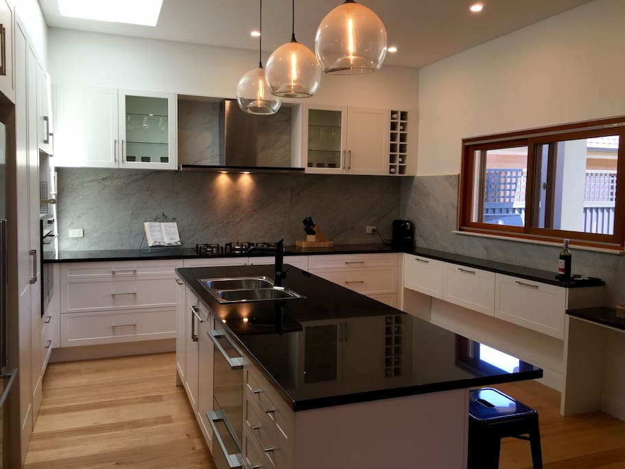 Beautiful kitchen, gas stove with granite bench top, double dish washer draw, electric stove