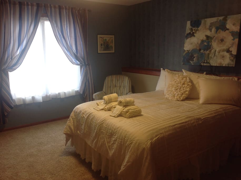 Queen bed. Reading chair. Inner spring mattress. Full closet. Southern exposure. Chest of drawers.