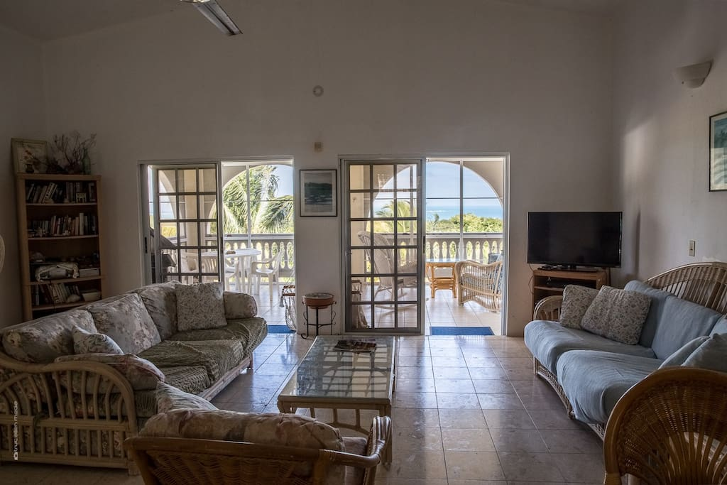 Airy open floor living area and a breathtaking back porch with views to the main island of Puerto Rico.