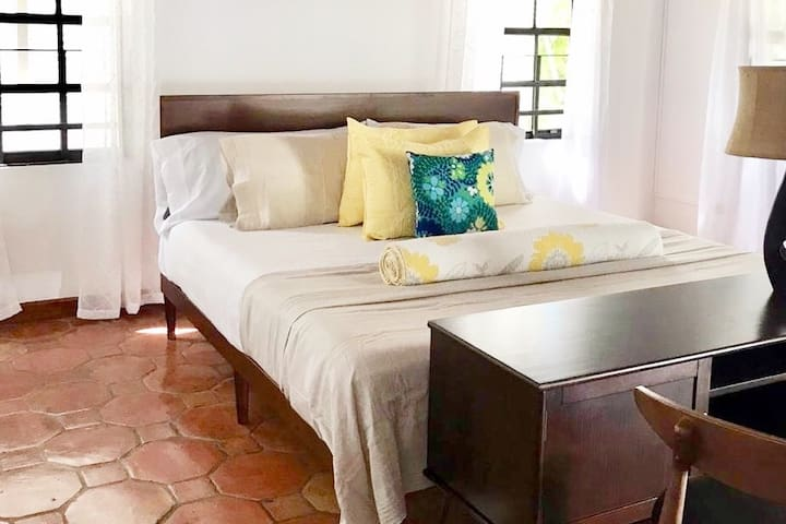 Beautiful terracotta floors complement newly furnished airy rooms