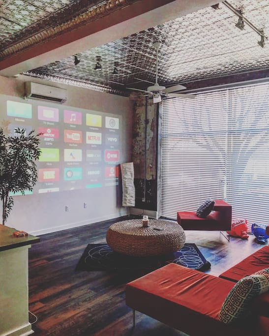 Living room space with Apple TV and projector!
