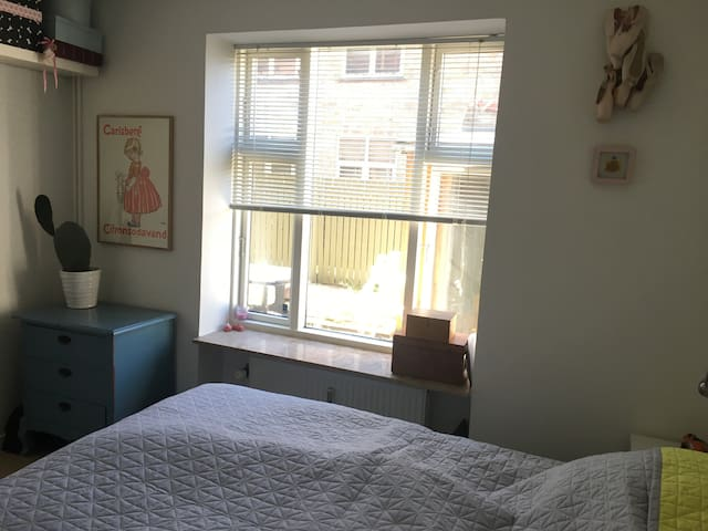 Bedroom with view to the back yard