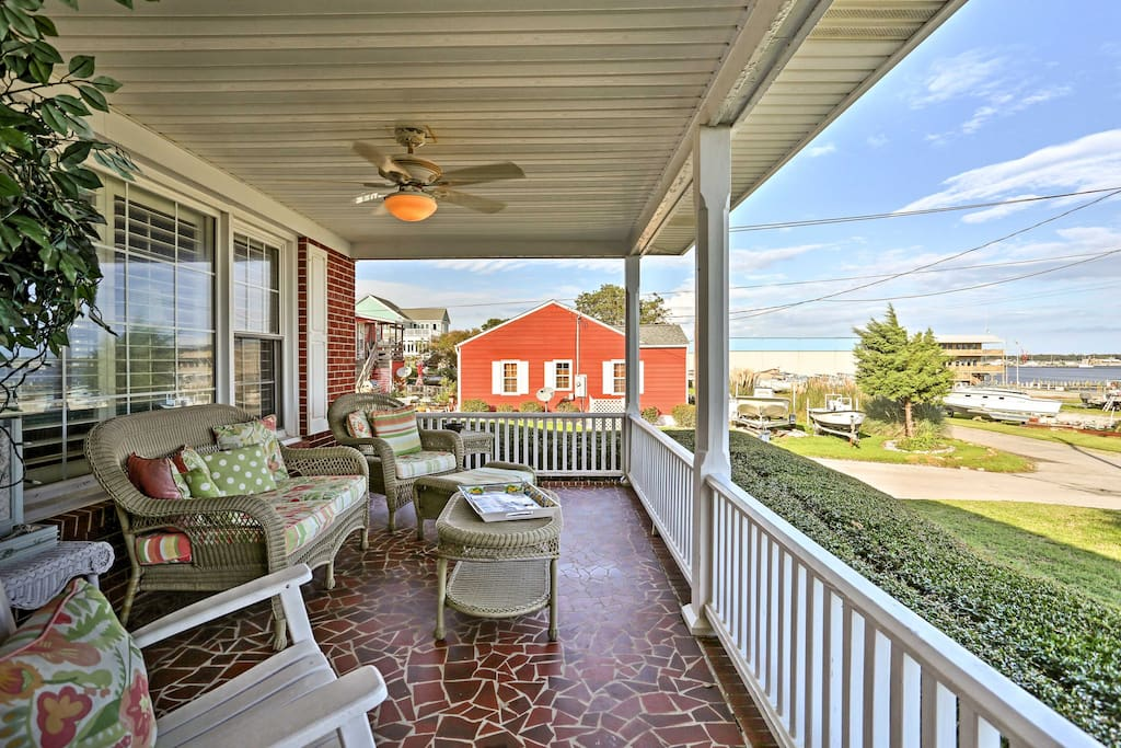 The front porch is sure to be a favorite spot during your stay, with unparalleled views overlooking the water!