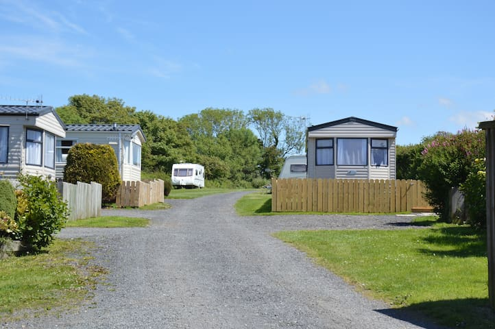 Cosy, stylish holiday caravan with private garden