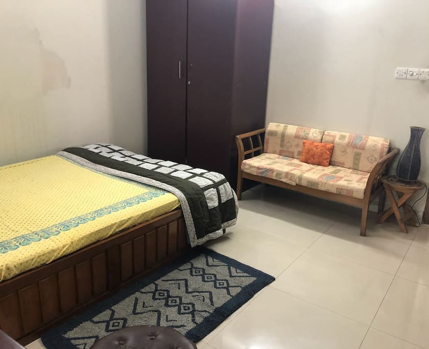 Bed with attached couch