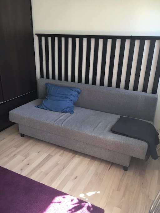 Couch that can be folded out, so it fits two people. I have a sheet for you too :-)