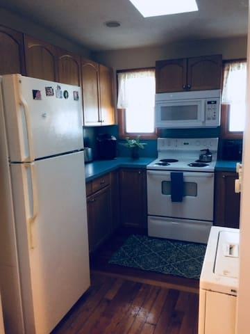 Efficient food and laundry area, stove, microwave, fridge, Keurig
