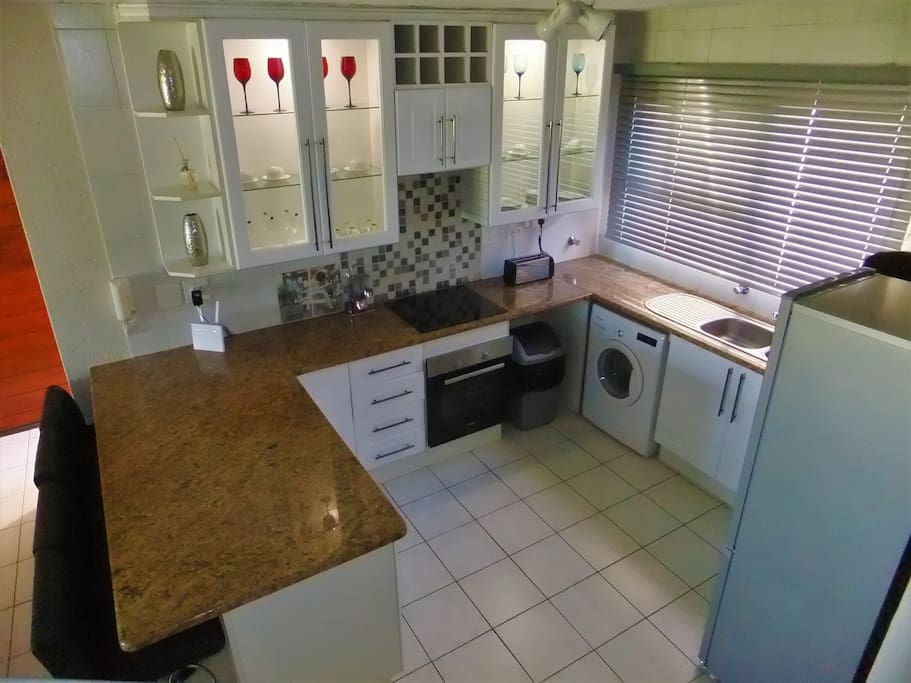 Fully equipped kitchen with brand new integrated appliances, fridge/freezer, washing machine and microwave.