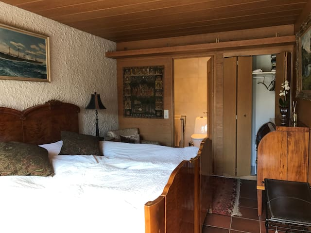 Room 1 has a king-size double bed with ensuite bathroom