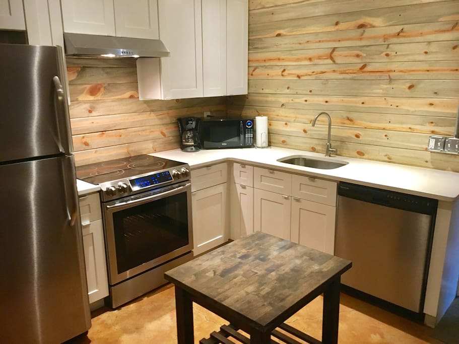 Colorado reclaimed beetle pine kitchen, white quartz countertops & soft close cabinets