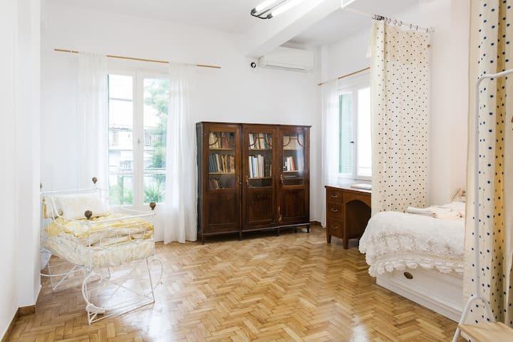 Bedroom with baby crib and study. The sunny balcony has a view to Lycabettos hill.