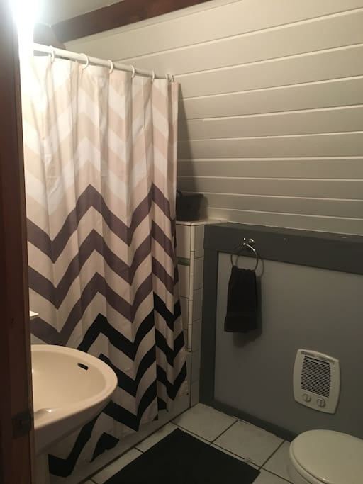 The bathroom is small, but it has all the necessities and the shower head has been recently replaced and has a nice water pressure.