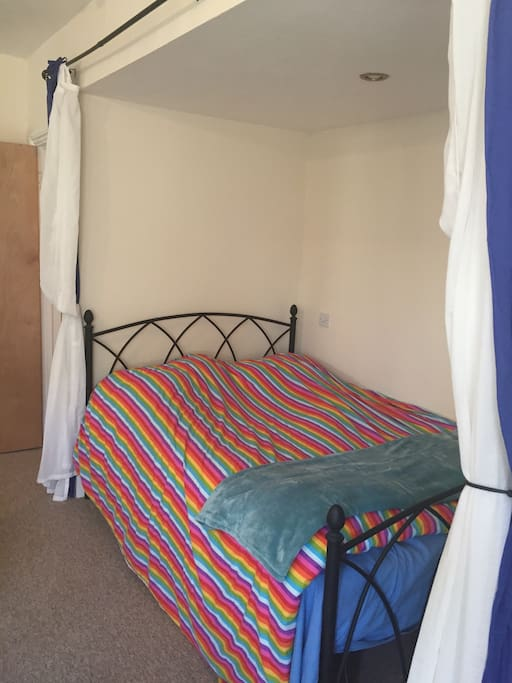 Double bed(new mattress ) with curtains to cosy away!