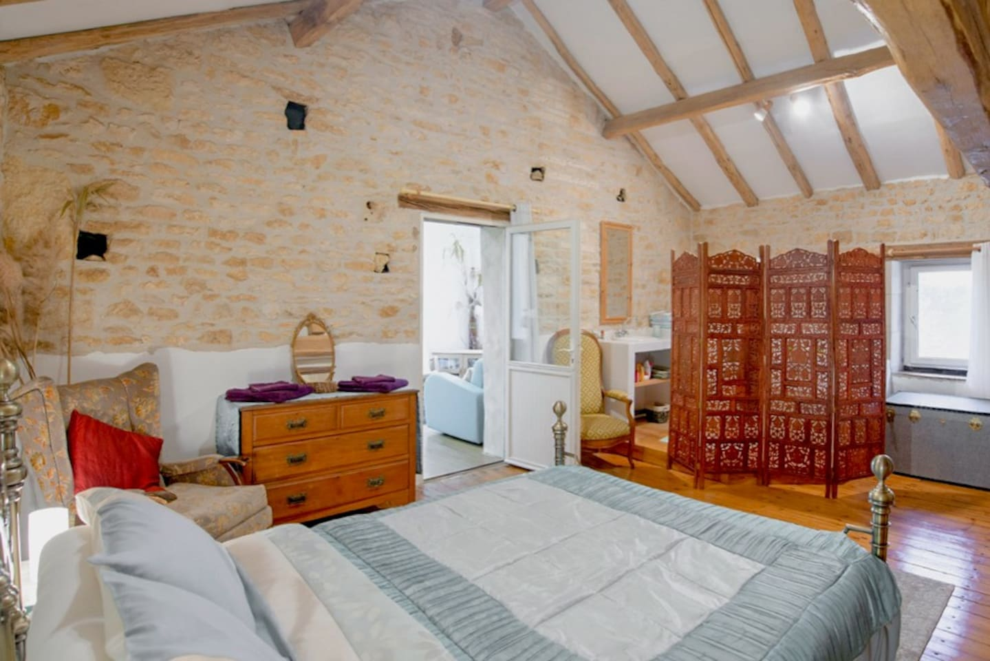 The Bedroom, with en-suite bath (obscured by the wooden screen) and separate shower room with toilet and washbasin. Door to the Studio/Lounge area, with TV (UK) and Blur-ray player. Exclusive to you, during your stay.