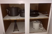 Non stick variety of Pots for easy cooking, a grater and water kettle