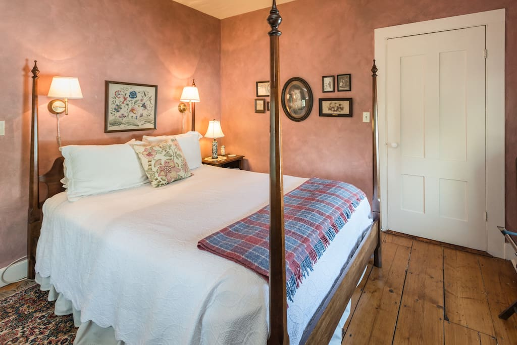Queen size four poster bed in our main guest room.  Antique Family photos from Mary's side of the family adorn the walls.