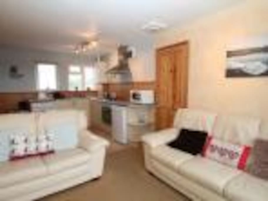 Lounge area has 2 sofas,   LCD tv,   dvd and freeview  --  patio doors lead to balcony with sea views