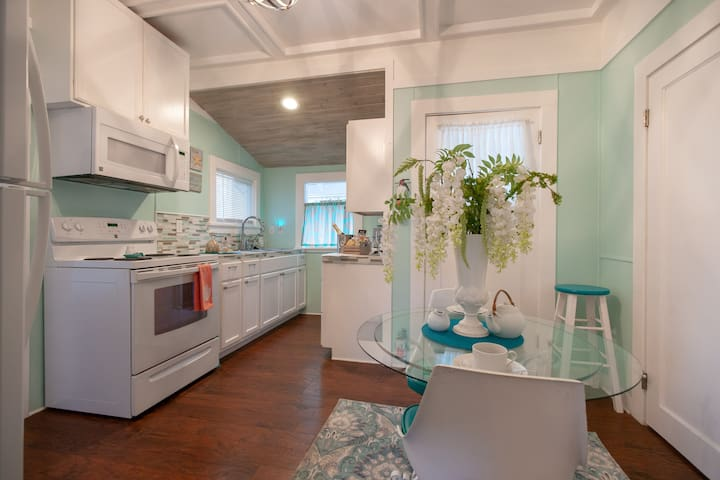 Kitchen and dining area.  Additional chairs are located in the laundry room.