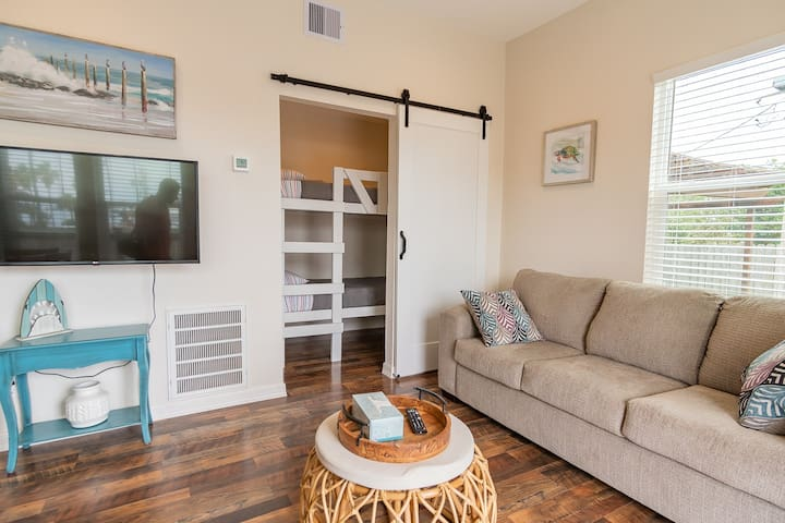 Living Area with Queen Sofa bed and Access to Twin Bunk beds with barn door for privacy