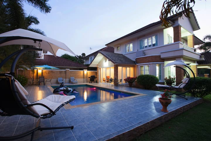 Privcate pool and our beautiful villa soon after sunset.