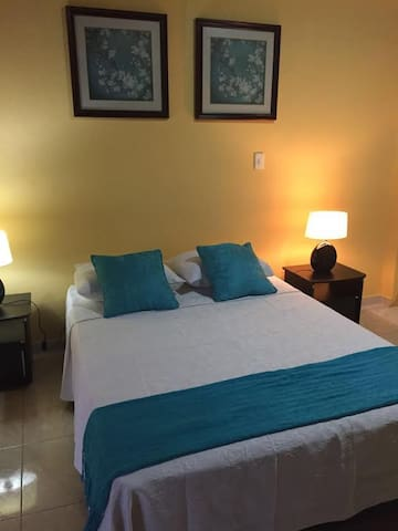 Double bed, private bathroom and AC