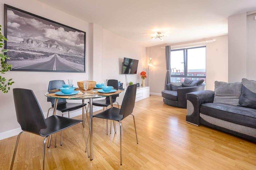 Large open plan living area with dining table for four guests. TV includes BT Sport, Netflix and iPlayer. Superfast wifi throughout. Large sofa and armchair.