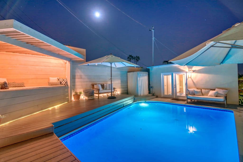 Heated pool, custom patio bed whitewashed Redwood fence w/ integrated lighting, outdoor speakers for BBQ, swimming or chill time
