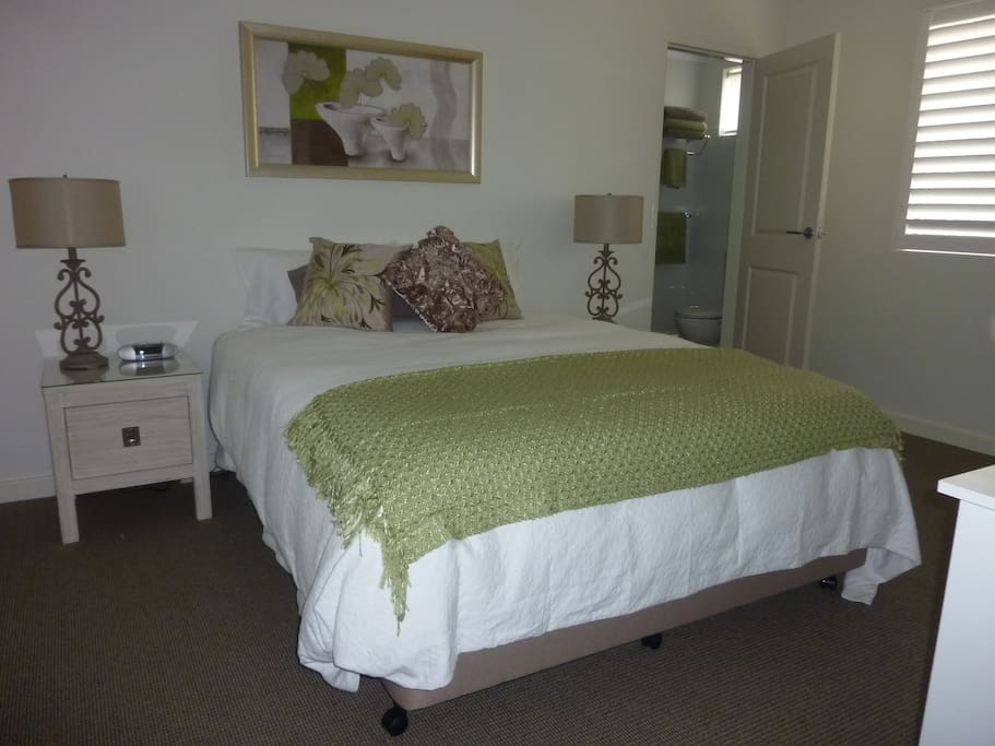 Main bedroom with queen bed,  ensuite, individual air conditioner and TV