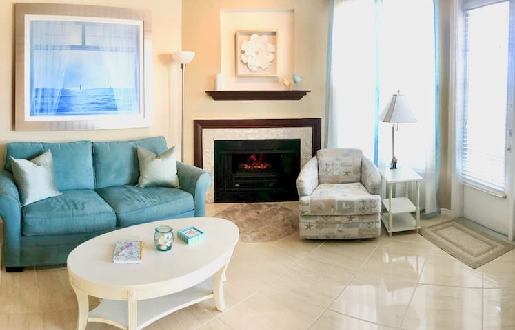 """Ember-glow fireplace and that """"ocean breeze"""" seascape for a touch of the romantic"""