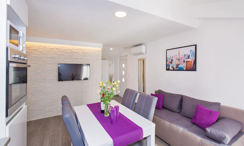 Comfortable dinning and living room in SUNSET APARTMENT