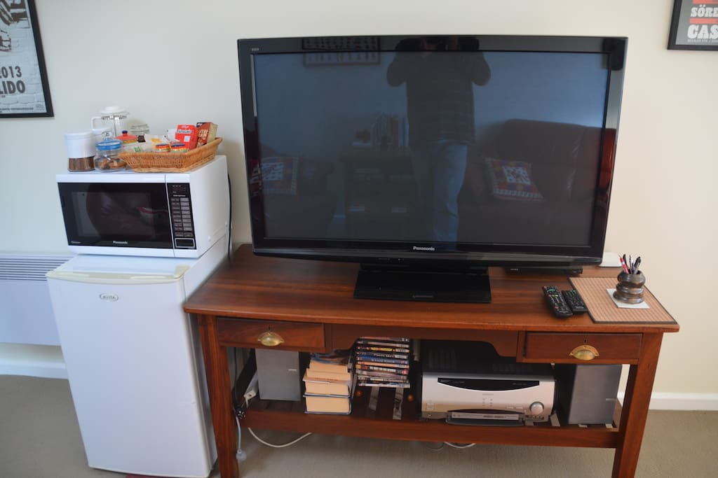 50 inch TV, DVD player (with a selection of DVD's), Stereo Receiver, Apple AirPlay, Unlimited Wi-Fi, books and games, even jigsaw puzzles.