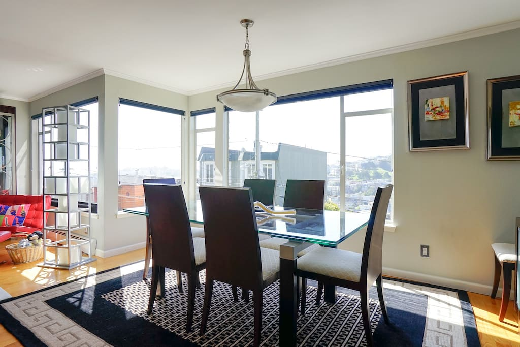 Dining room has sweeping, dramatic views from Twin Peaks down to Eureka Valley down to the Bay