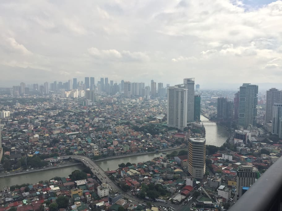 Views of Mandaluyong and Quezon cities skylines.