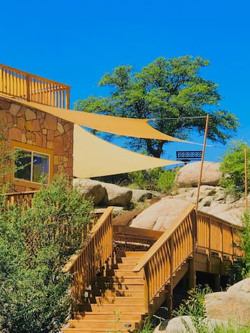 One of the Cave Castle's many view decks with sun sails that offer cool zephyrs in the summer. From this deck the private canyon, pond, pool, spa, hammock and lawn can be seen.