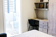 Third Bedroom equipped with desk and cupboards