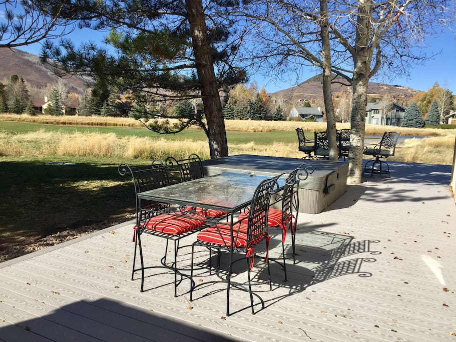 Very Very Private wrap around deck with 7-person hot tub, large barbecue, two table sets with chairs and endless ski mountain views overlooking the golf course.
