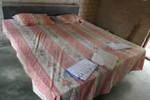 One of the twos bedroom with the mattresses,  towels, sheets