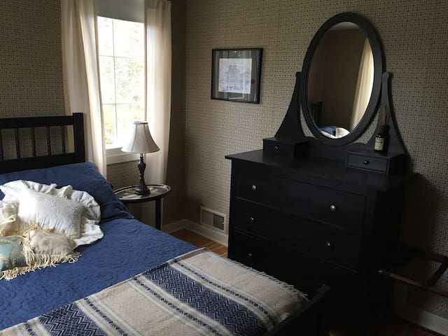 Double bed,  dresser, and closet