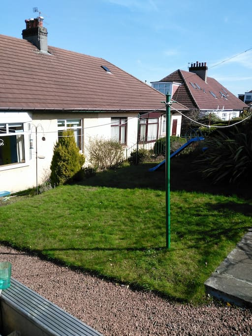 Mature back garden with decking area and lawn.  South facing.