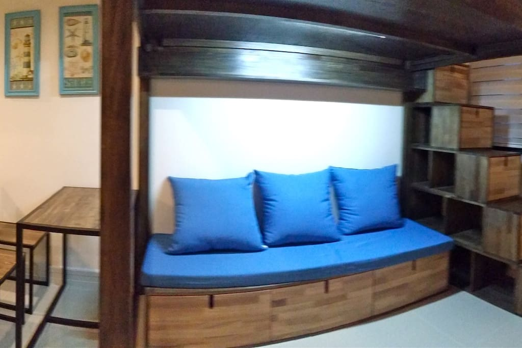 sofa where you can enjoy your tv shows, can be used as single bed as well. storage spaces available.
