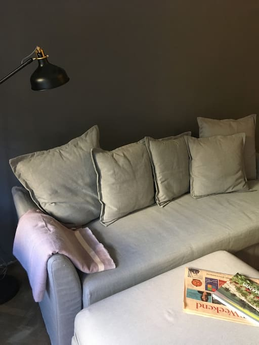 Large sofa in open space lounge/kitchen