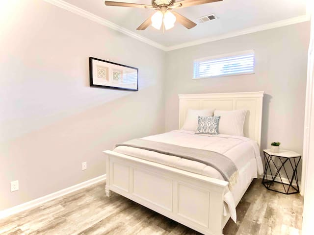 The second bedroom has a queen bed  ideal for two guests