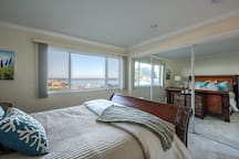 Master bedroom has a view of the bay.