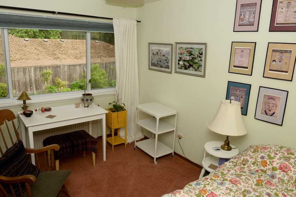 The Healing Oasis Room is freshly painted room with very comfortable single bed, table/desk overlooking garden, rocking chair & cart for storage.