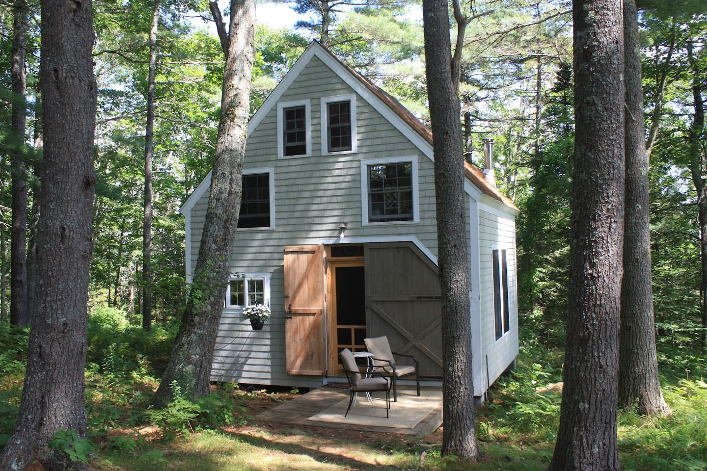 Rustic 19' x 16' two-story cottage in the woods.