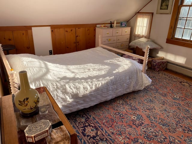 Master bedroom with double bed and ceiling fan